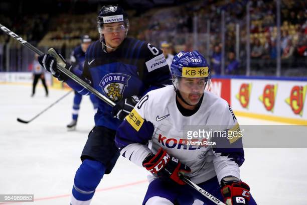 Julius Honka of Finland and Michael Swift of Korea battle for the puck during the 2018 IIHF Ice Hockey World Championship group stage game between...