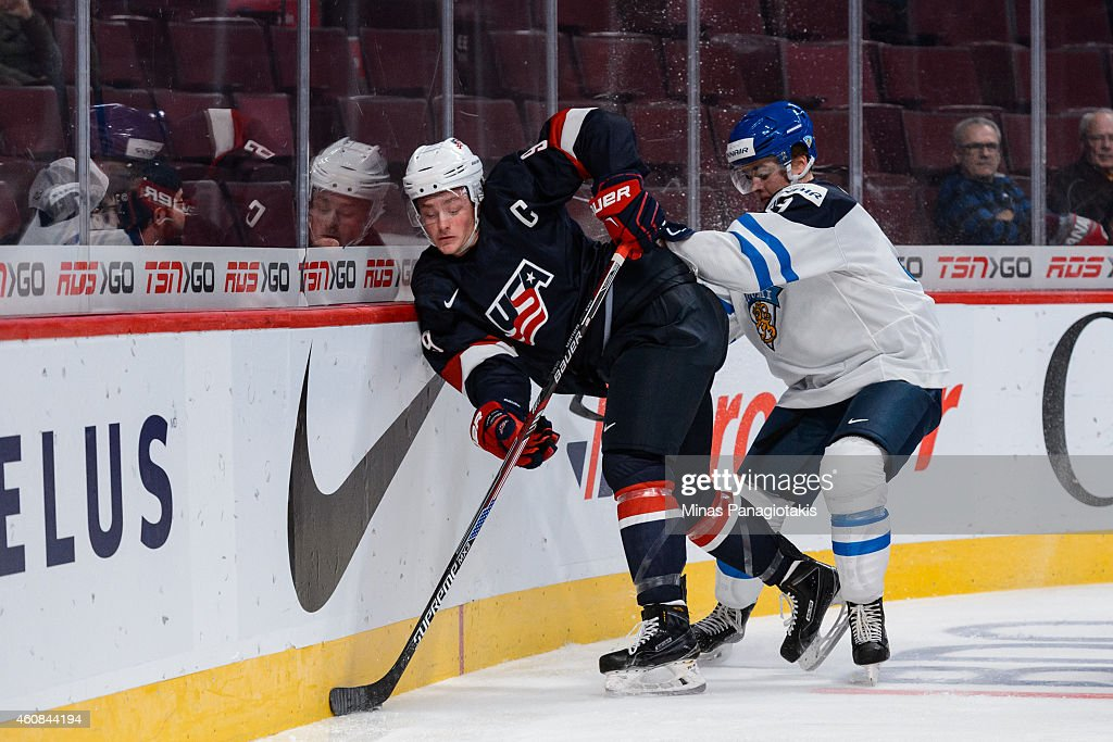 Julius Honka #9 of Team Finland checks Jack Eichel #9 of Team United States into the boards during the 2015 IIHF World Junior Hockey Championship game at the Bell Centre on December 26, 2014 in Montreal, Quebec, Canada.