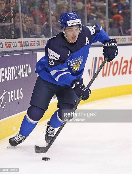 Julius Honka of Team Finland skates with the puck against Team Sweden during a quarterfinal game in the 2015 IIHF World Junior Hockey Championship at...