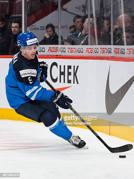 Julius Honka of Team Finland skates with the puck in a preliminary round game during the 2015 IIHF World Junior Hockey Championships against Team...