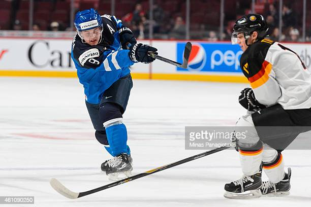 Julius Honka of Team Finland takes a shot in a preliminary round game during the 2015 IIHF World Junior Hockey Championships against Team Germany at...