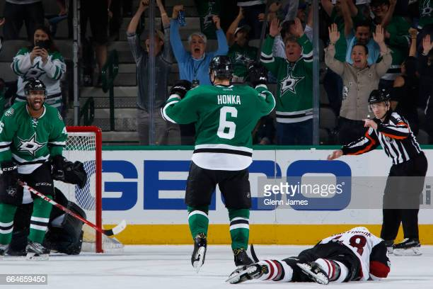 Julius Honka of the Dallas Stars celebrates a gamewinning overtime goal against the Arizona Coyotes at the American Airlines Center on April 4 2017...