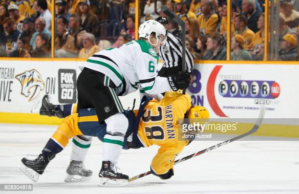 Julius Honka of the Dallas Stars cross checks Ryan Hartman of the Nashville Predators during an NHL game at Bridgestone Arena on March 6 2018 in...