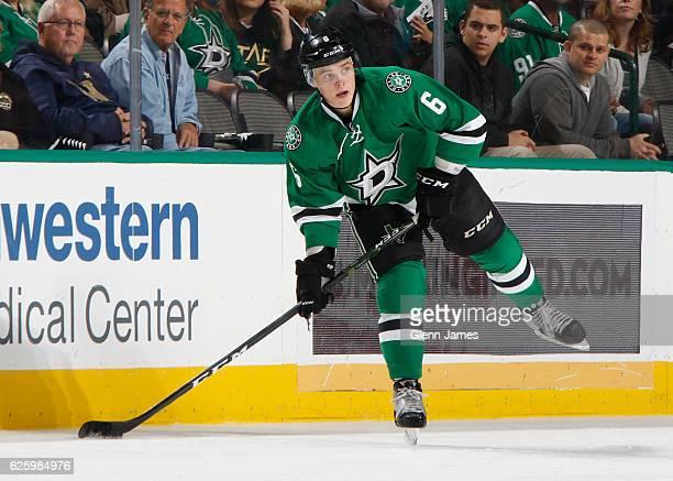 Julius Honka of the Dallas Stars handles the puck against the Minnesota Wild at the American Airlines Center on November 21 2016 in Dallas Texas