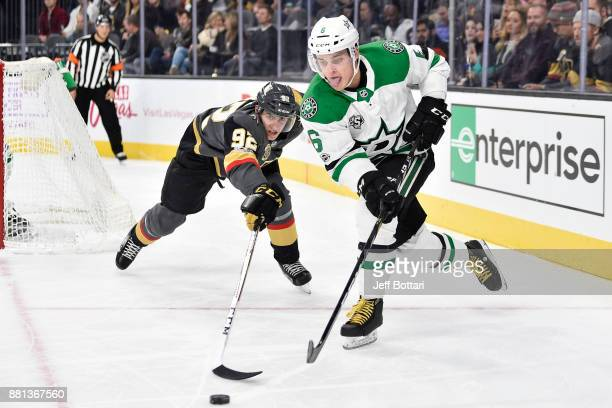 Julius Honka of the Dallas Stars handles the puck while Tomas Nosek of the Vegas Golden Knights defends during the game at TMobile Arena on November...