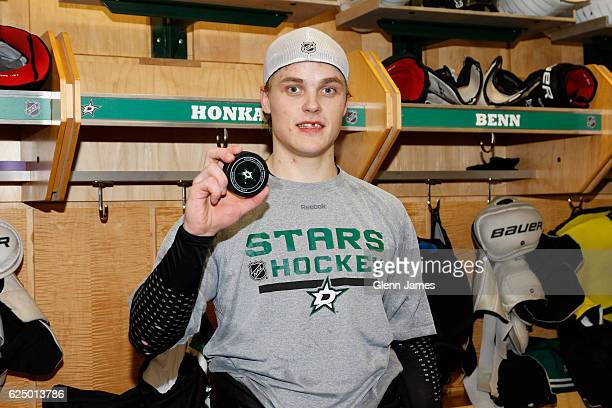 Julius Honka of the Dallas Stars shows off the puck from his first career NHL point against the Minnesota Wild at the American Airlines Center on...