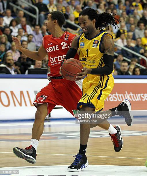 Julius Jenkins of Berlin challenges for the ball with Brian Roberts of Bamberg during the Beko Basketball Bundesliga match between Alba Berlin and...