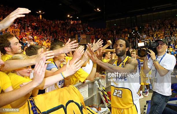 Julius Jenkins of Oldenburg celebrates after winning game 5 of the semifinals of the Beko BBL playoffs between EWE Baskets Oldenburg and Ratiopharm...