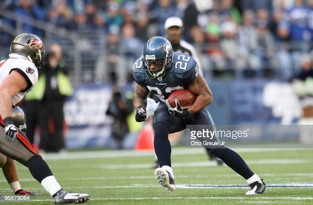 Julius Jones of the Seattle Seahawks runs with the ball for yardage during their game against the Tampa Bay Buccaneers on December 20 2009 at Qwest...
