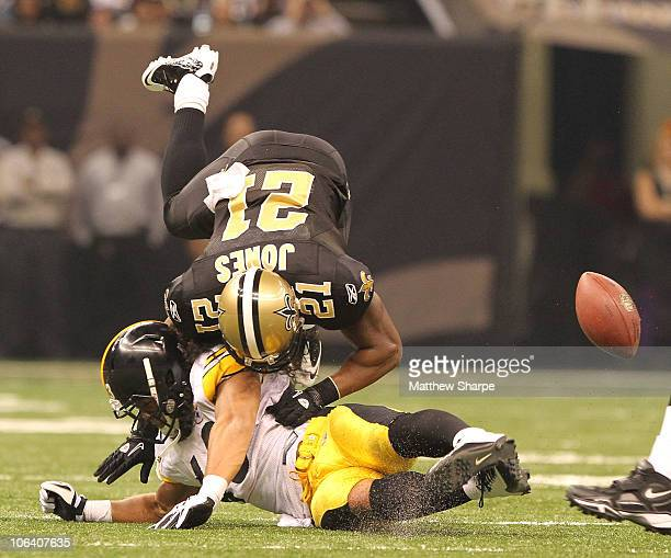 Julius Jones the New Orleans Saints is upended by Troy Polamalu of the Pittsburgh Steelers at the Louisiana Superdome on October 31 2010 in New...