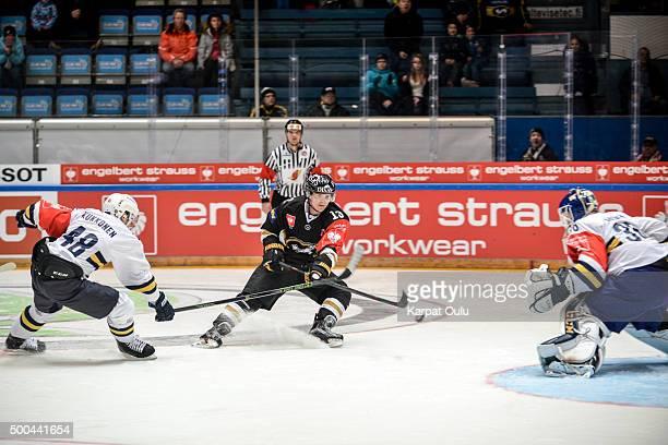 Julius Junttila of Karpat Oulu takes a shot on goal defended by Mikko Kukkonen of Espoo Blues during the Champions Hockey League quarter final...