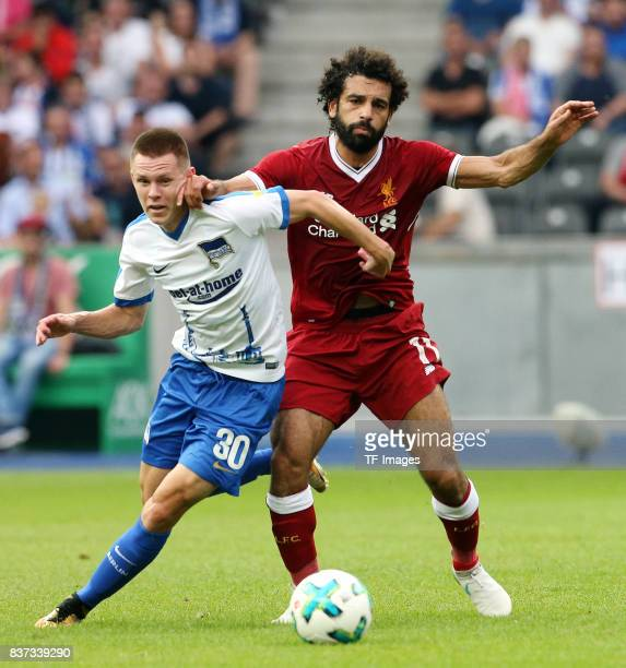 Julius Kade of Hertha and Mohamed Salah of Liverpool battle for the ball during the Preseason Friendly match between Hertha BSC and FC Liverpool at...