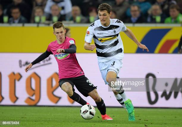 Julius Kade of Hertha BSC and Andreas Christensen of Borussia Moenchengladbach during the game between Borussia Moenchengladbach and Hertha BSC on...
