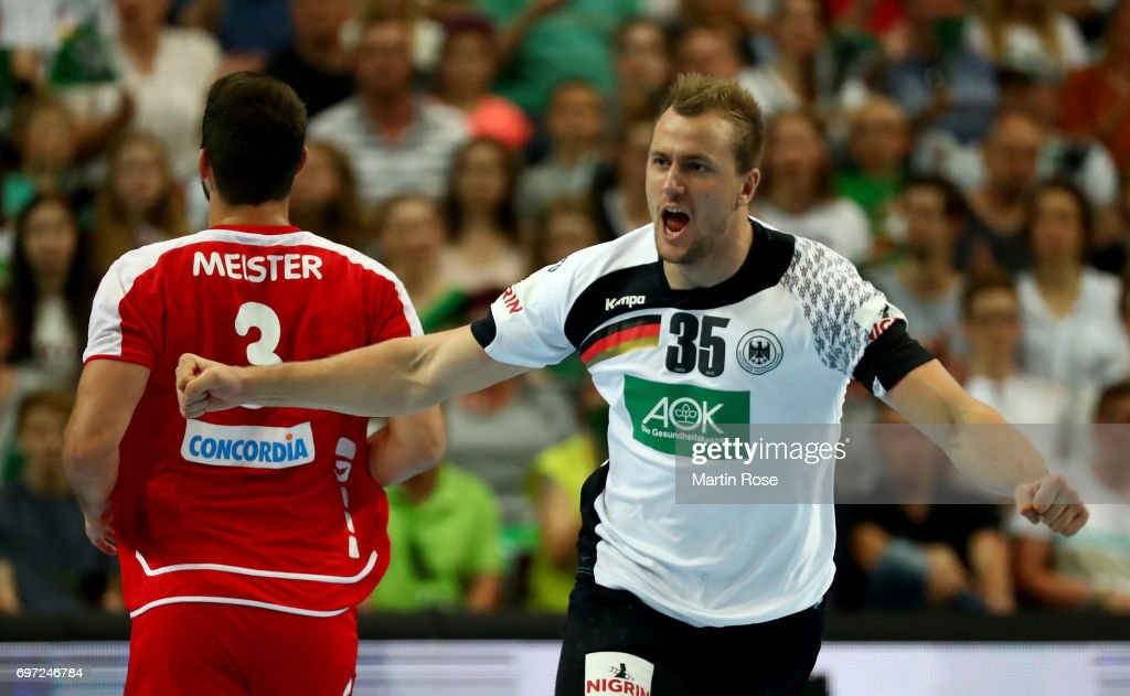 Julius Kuehn of Germany celebrates after scoring during the 2018 EHF European Championship Qualifier between Germany and Switzerland at OVB-Arena on June 18, 2017 in Bremen, Germany.