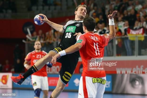 Julius Kuehn of Germany is challenged by Rasmus Lauge Schmidt of Denmark during the Men's Handball European Championship main round group 2 match...