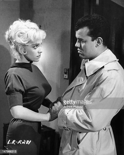 Julius LaRosa resists the advances of pickup girl Joy Harmon in a scene from the film 'Let's Rock' 1958