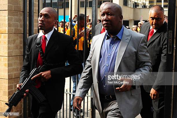 Julius Malema flanked by at heavily armed guards arrives at the High Court in Johannesburg, 14 April 2011.Julius Malema is facing charges of Hate...