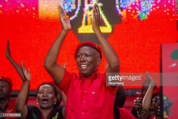 Julius Malema, leader of the Economic Freedom Fighters , applauds the audience at a party rally in Soweto, Johannesburg, South Africa, on Sunday, May...
