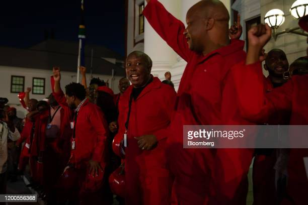 Julius Malema, leader of the Economic Freedom Fighters , center, stands with party members outside Parliament during the state of the nation ceremony...