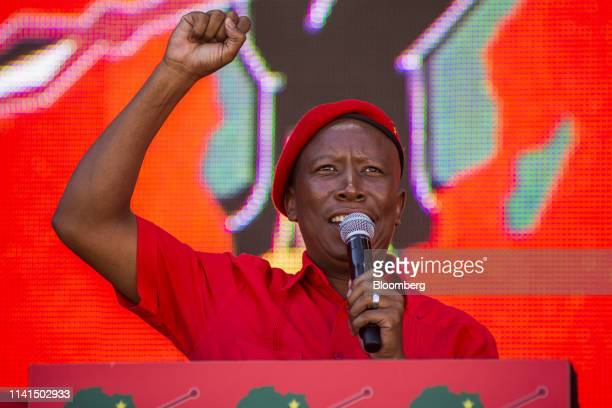 Julius Malema, leader of the Economic Freedom Fighters , gestures as he speaks at a party rally in Soweto, Johannesburg, South Africa, on Sunday, May...