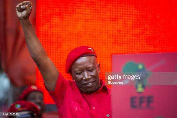 Julius Malema, leader of the Economic Freedom Fighters , raises his fist in the air at a party rally in Soweto, Johannesburg, South Africa, on...