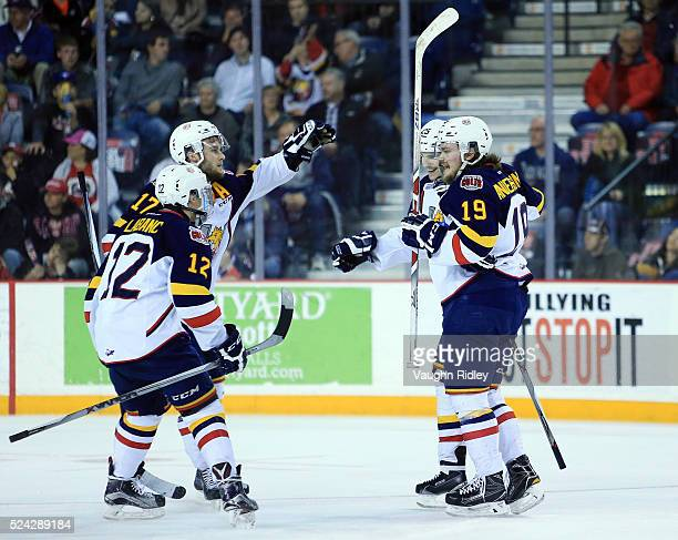 Julius Nattinen of the Barrie Colts celebrates a goal with Kevin Lebanc Justin Scott and Rasmus Andersson during the first period against the Niagara...