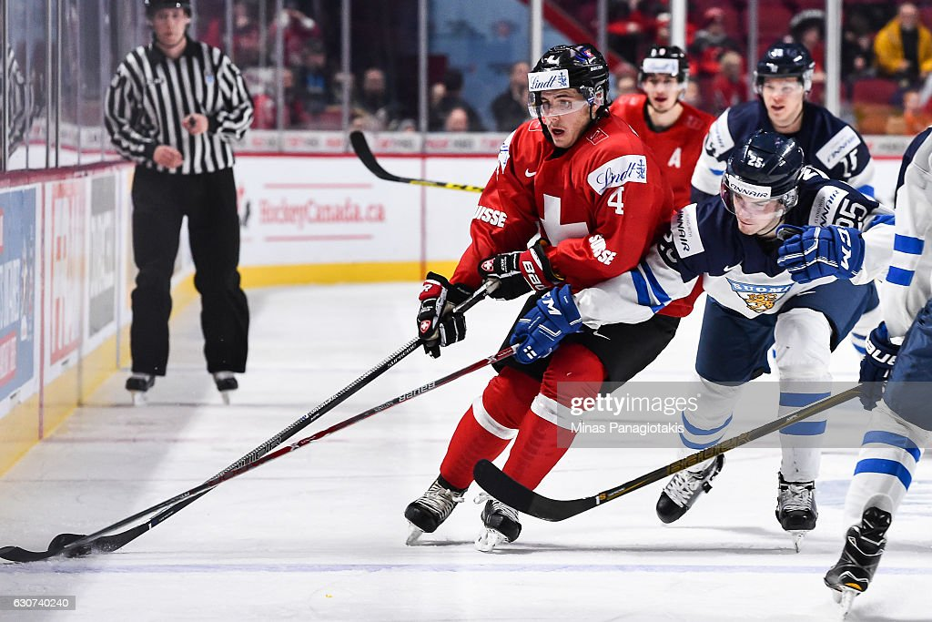 Julius Nattinen #25 of Team Finland challenges Roger Karrer #4 of Team Switzerland during the 2017 IIHF World Junior Championship preliminary round game at the Bell Centre on December 31, 2016 in Montreal, Quebec, Canada. Team Finland defeated Team Switzerland 2-0.