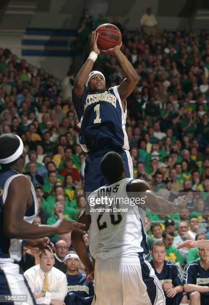 Julius Page of Pittsburgh takes a jump shot over Torrian Jones of Notre Dame during the game at Joyce Center at the University of Notre Dame on...