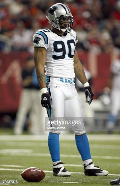 Julius Peppers of the Carolina Panthers stands on the field during the game against the Atlanta Falcons on December 24 2006 at The Georgia Dome in...