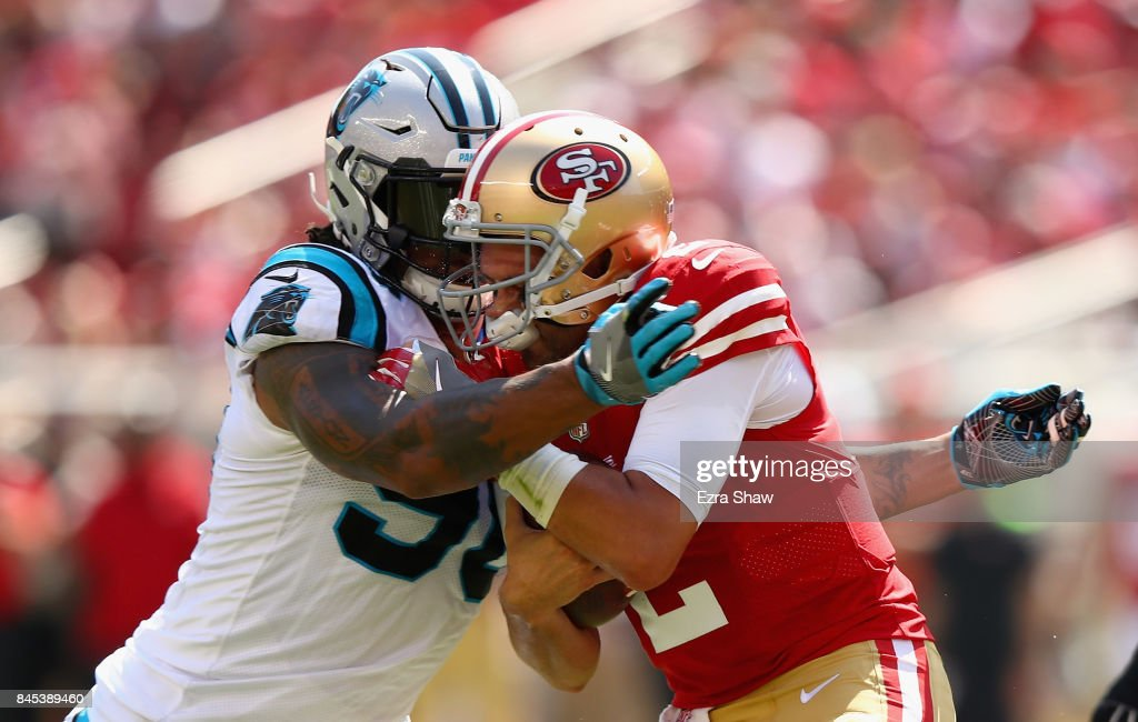 Julius Peppers #90 of the Carolina Panthers tackled Brian Hoyer #2 of the San Francisco 49ers at Levi's Stadium on September 10, 2017 in Santa Clara, California.