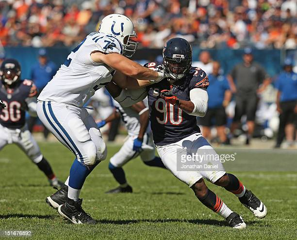 Julius Peppers of the Chicago Bears rushes against Jeff Linkenbach of the Indianapolis Colts during their 2012 NFL season opener at Soldier Field on...