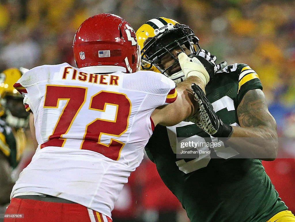 Julius Peppers #56 of the Green Bay Packers rushes against Eric Fisher #72 of the Kansas City Chiefs at Lambeau Field on September 28, 2015 in Green Bay, Wisconsin. The Packers defeated the Chiefs 38-28.