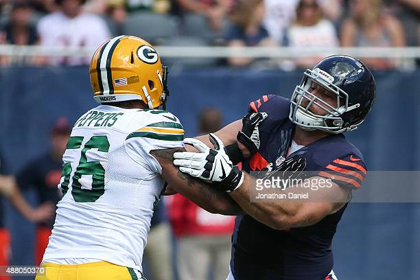 Julius Peppers of the Green Bay Packers rushes against Kyle Long of the Chicago Bears in the first quarter at Soldier Field on September 13 2015 in...