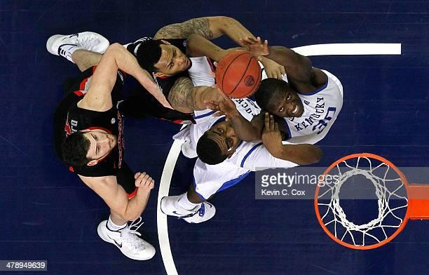 Julius Randle and Dakari Johnson of the Kentucky Wildcats battles for a rebound against Marcus Thornton and Nemanja Djurisic of the Georgia Bulldogs...