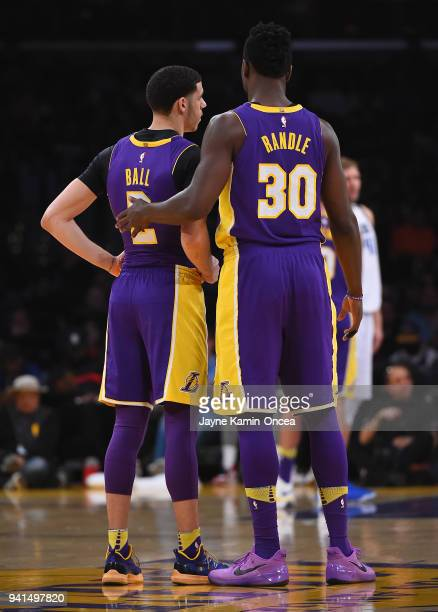 Julius Randle and Lonzo Ball of the Los Angeles Lakers wait on the court during a time out in the game against the Dallas Mavericks at Staples Center...