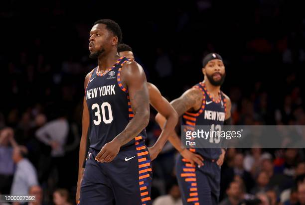 Julius Randle and Marcus Morris Sr. #13 of the New York Knicks react late in the game against the Phoenix Suns at Madison Square Garden on January...