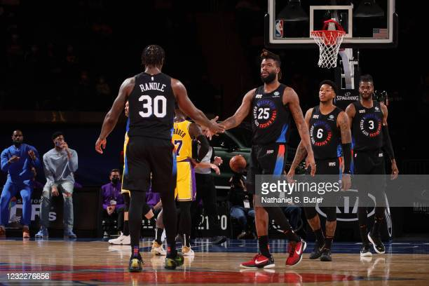 Julius Randle and Reggie Bullock of the New York Knicks shake hands during the game against the Los Angeles Lakers on April 12, 2021 at Madison...