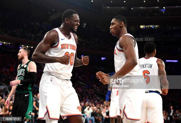 Julius Randle and RJ Barrett of the New York Knicks react to a foul call in the first half of their game against the Boston Celtics at Madison Square...