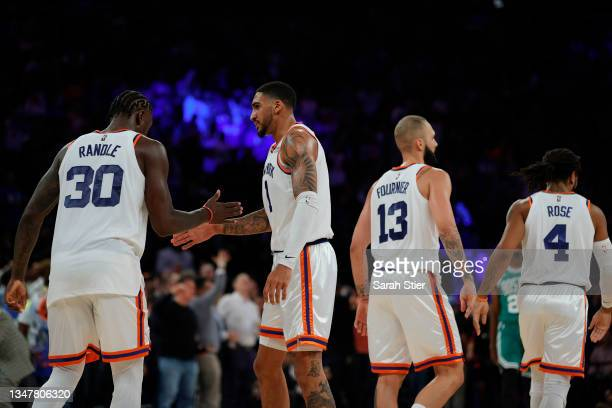 Julius Randle high-fives Obi Toppin of the New York Knicks during the se against the Boston Celtics at Madison Square Garden on October 20, 2021 in...
