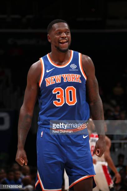 Julius Randle of New York Knicks smiles during the game against the Washington Wizards during pre-season on October 7, 2019 at Capital One Arena in...