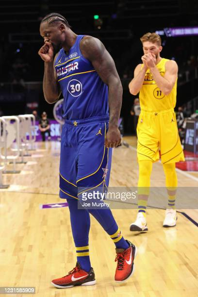Julius Randle of Team Durant and Domantas Sabonis of Team LeBron walk on the court during the Taco Bell Skills Challenge as part of 2021 NBA All Star...