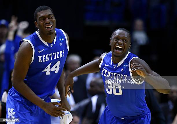 Julius Randle of the Kentucky Wildcats celebrates with teammate Dakari Johnson after defeating the Wichita State Shockers 78 to 76 during the third...