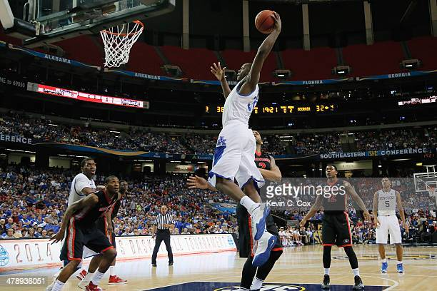 Julius Randle of the Kentucky Wildcats dunks the ball against the Georgia Bulldogs during the semifinals of the SEC Men's Basketball Tournament at...