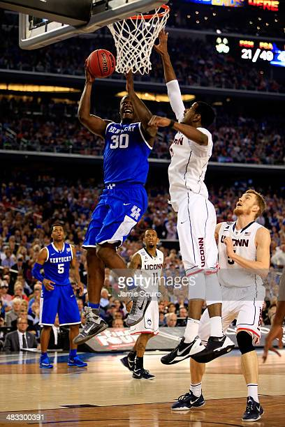 Julius Randle of the Kentucky Wildcats goes to the basket as DeAndre Daniels of the Connecticut Huskies defends during the NCAA Men's Final Four...