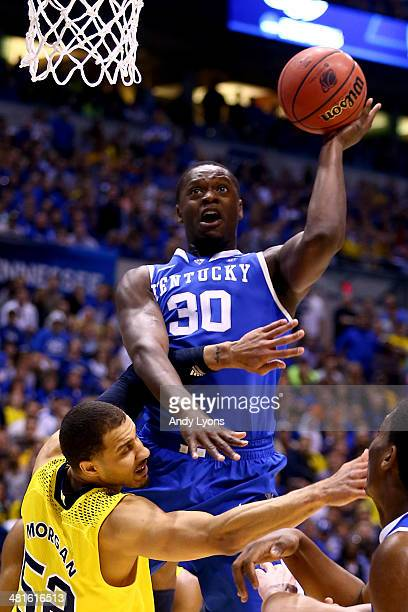 Julius Randle of the Kentucky Wildcats shoots the ball over Jordan Morgan of the Michigan Wolverines in the first half during the midwest regional...