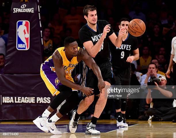 Julius Randle of the Los Angeles Lakers and Nemanja Bjelica of the Minnesota Timberwolves reach for a ball during a 112111 Timberwolves win at...