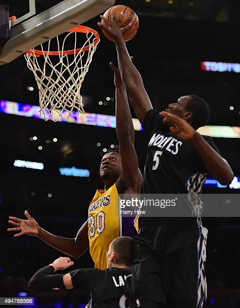 Julius Randle of the Los Angeles Lakers attempts a layup over Gorgui Dieng of the Minnesota Timberwolves during the first quarter at Staples Center...
