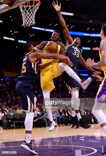 Julius Randle of the Los Angeles Lakers attempts a shot between Derrick Favors and Ekpe Udoh of the Utah Jazz during the first half at Staples Center...