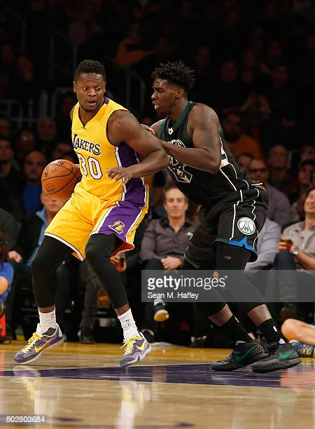 Julius Randle of the Los Angeles Lakers battles Johnny O'Bryant III of the Milwaukee Bucks for a loose ball during a game at Staples Center on...