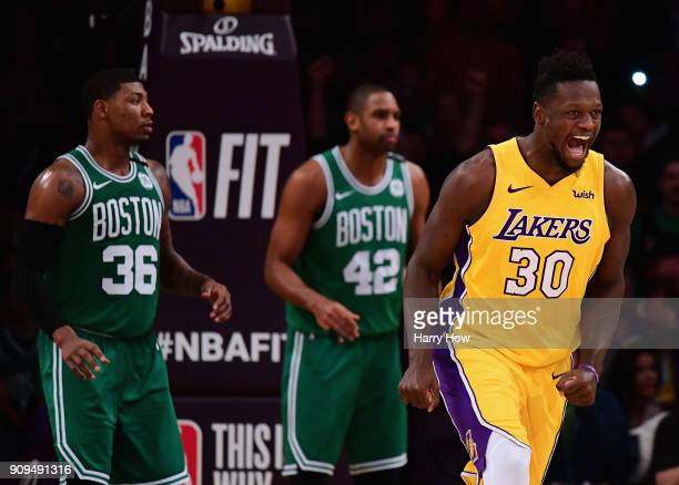 Julius Randle of the Los Angeles Lakers celebrates after his dunk in front of Marcus Smart and Al Horford of the Boston Celtics during a 108107...